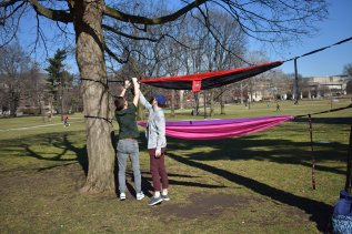 Caleb and his roomate Cade putting up the hammocks